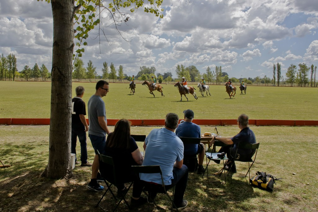 In this Feb. 27, 2018 photo, a group of tourists from Britain, Russia, Iceland and the U.S. watch a polo match at La Carona club, Capilla del Senor, B