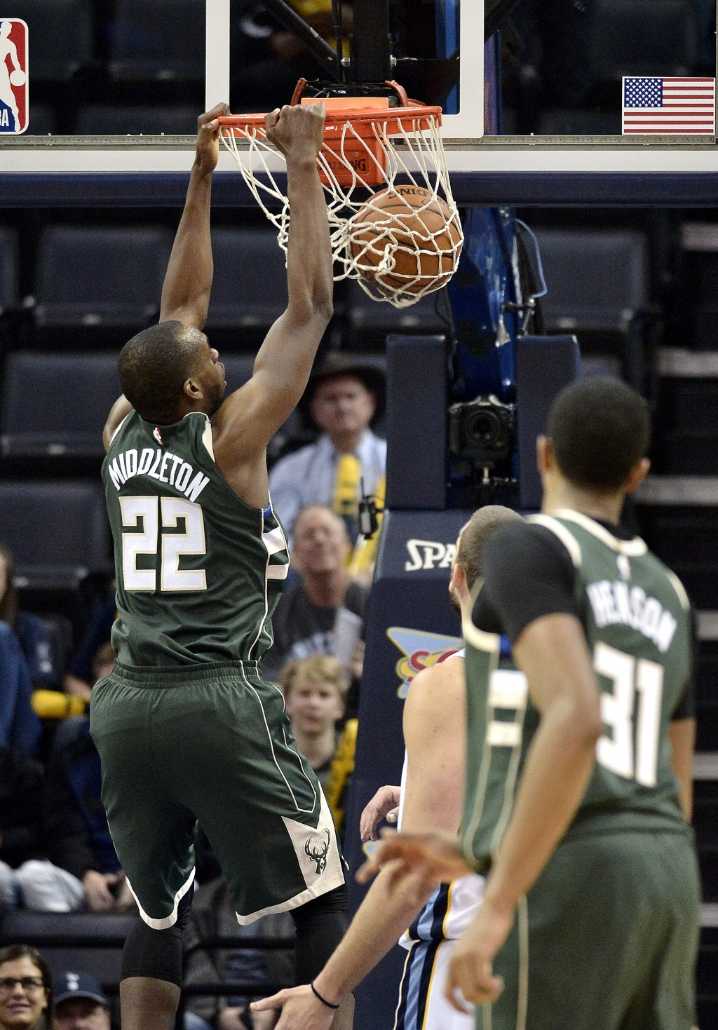 Milwaukee Bucks forward Khris Middleton (22) dunks in the second half of an NBA basketball game against the Memphis Grizzlies, Monday, March 12, 2018,