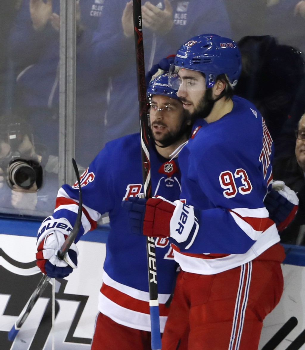 New York Rangers right wing Mats Zuccarello (36), of Norway, celebrates with center Mika Zibanejad (93), of Sweden, after scoring during the first per