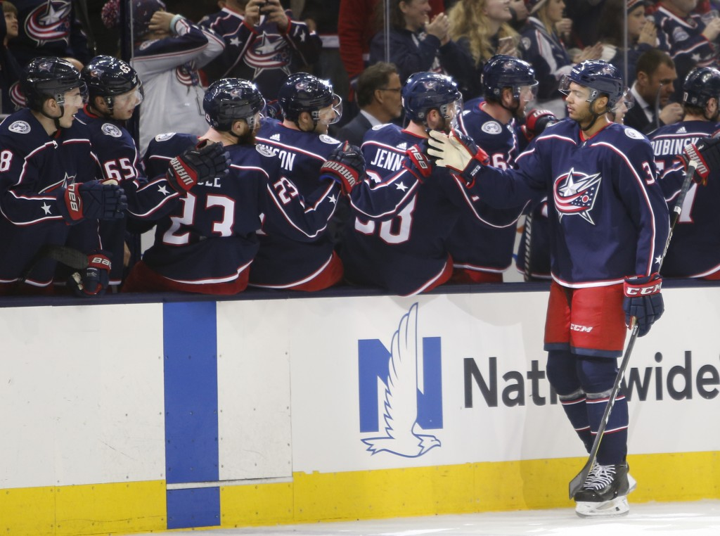 Columbus Blue Jackets' Seth Jones, right, celebrates his goal against the Montreal Canadiens during the first period of an NHL hockey game Monday, Mar