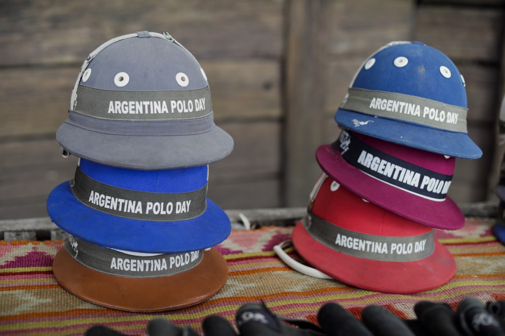 In this Feb. 27, 2018 photo, polo helmets for tourists lay stacked on a table at La Carona club, Capilla del Senor, Buenos Aires province, Argentina.