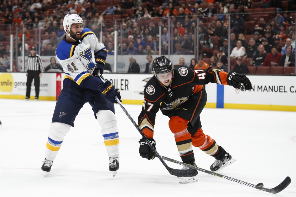 St. Louis Blues' Robert Bortuzzo (41) shoots under pressure by Anaheim Ducks' Hampus Lindholm, of Sweden, during the first period of an NHL hockey gam