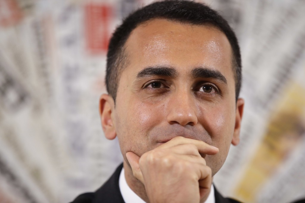 Five-Star Movement's leader Luigi Di Maio listens reporters' questions during a press conference at the foreign press association headquarters in Rome