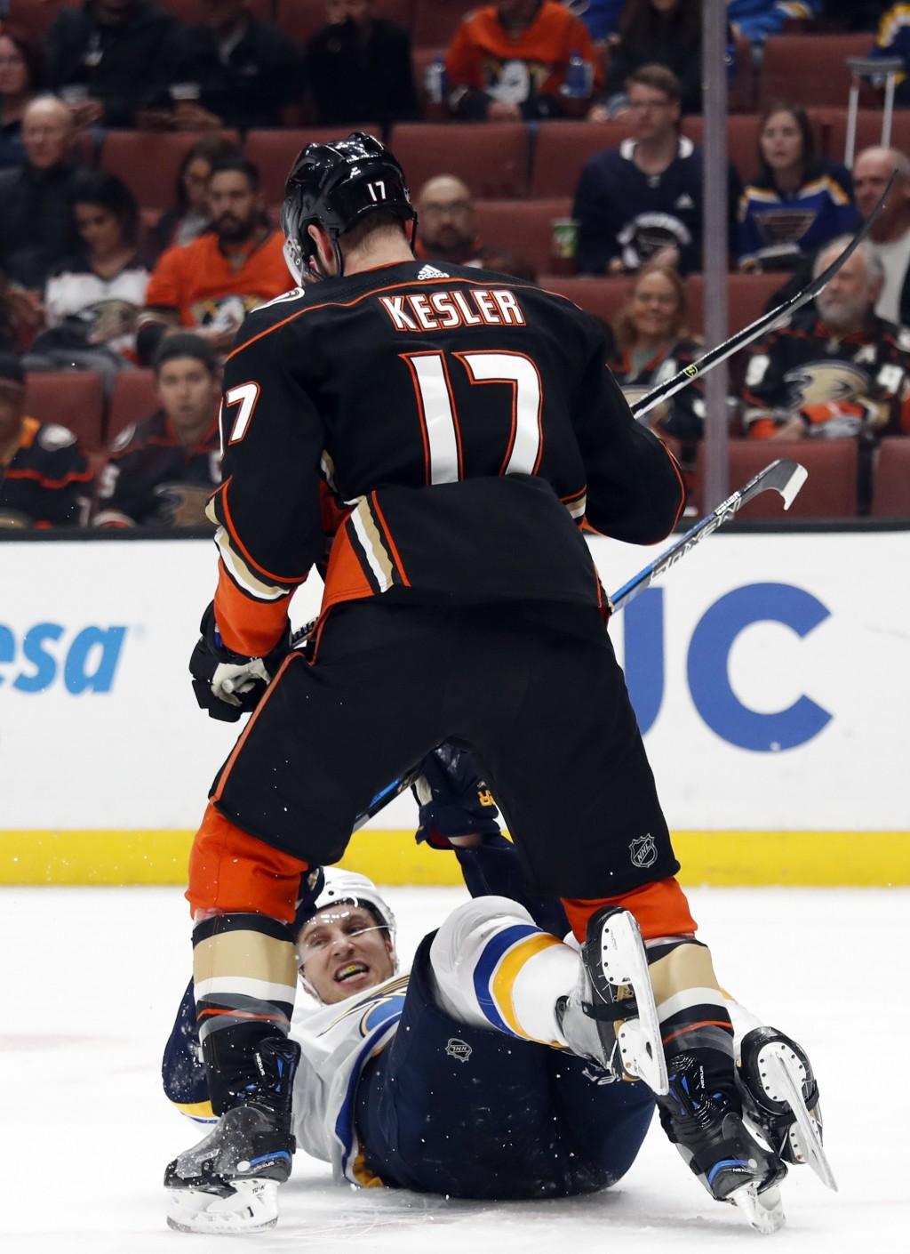 Anaheim Ducks' Ryan Kesler, top, shoves St. Louis Blues' Brayden Schenn during the first period of an NHL hockey game Monday, March 12, 2018, in Anahe