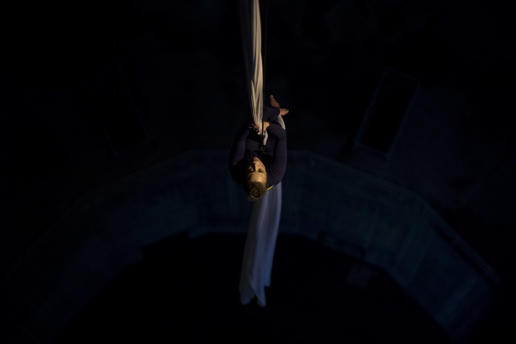 Aerial Dancer Katerina Soldatou performs suspended inside a hollow pylon supporting the Rio-Antirrio bridge in southern Greece, on Monday, March 12, 2