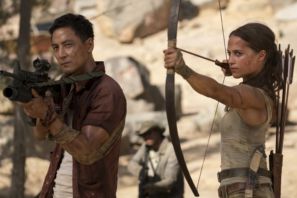 """This image released by Warner Bros. Pictures shows Daniel Wu, left, and Alicia Vikander in a scene from """"Tomb Raider."""" (Ilze Kitshoff/Warner Bros. Pic"""