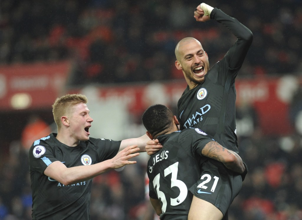 Manchester City's David Silva, right, celebrates scoring his second goal during the English Premier League soccer match between Stoke City and Manches
