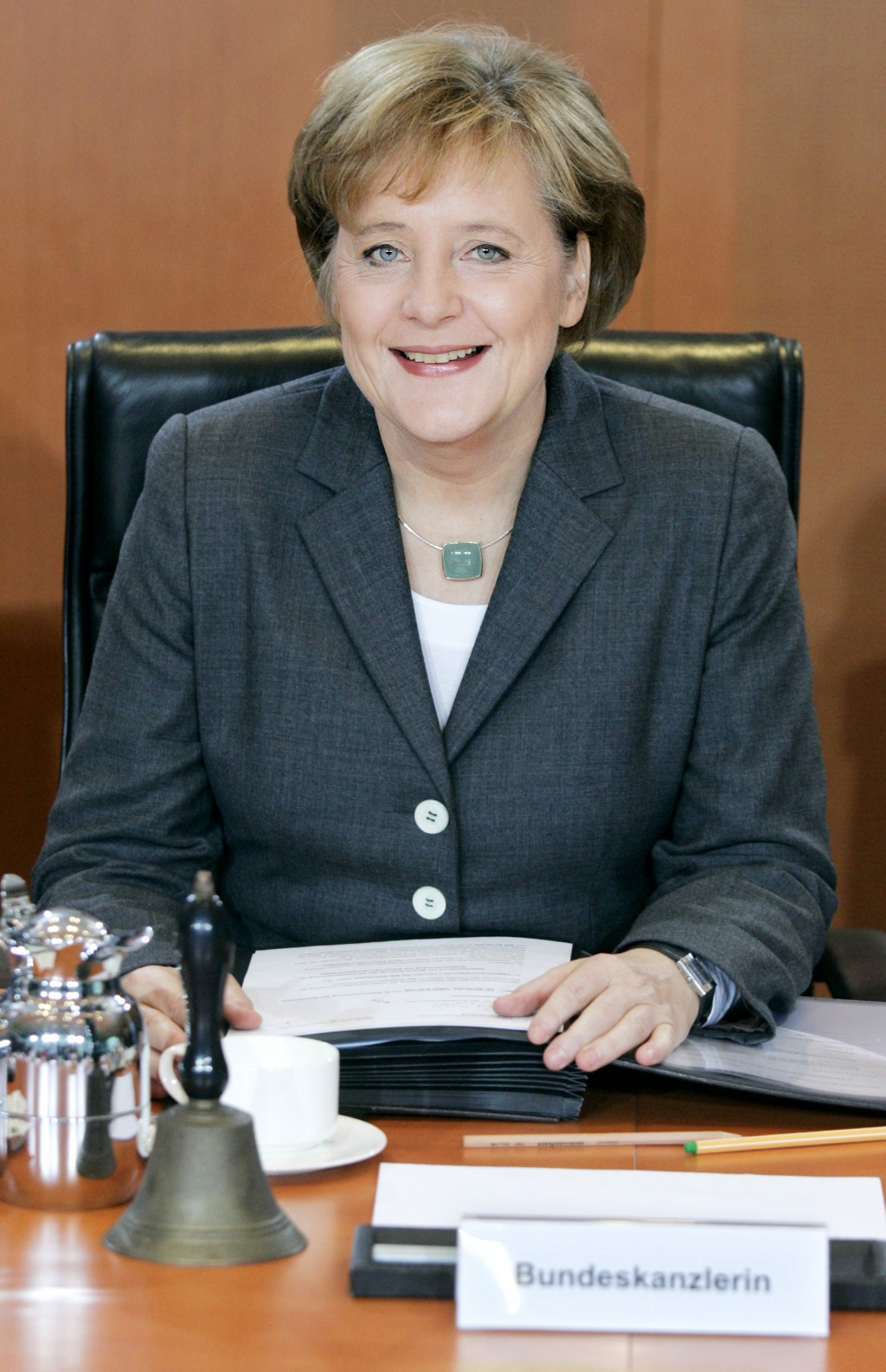 FILE - In this Nov. 24, 2005 fiel photo Germany's new Chancellor Angela Merkel chairs the first working meeting of the cabinet in the Chancellery in B