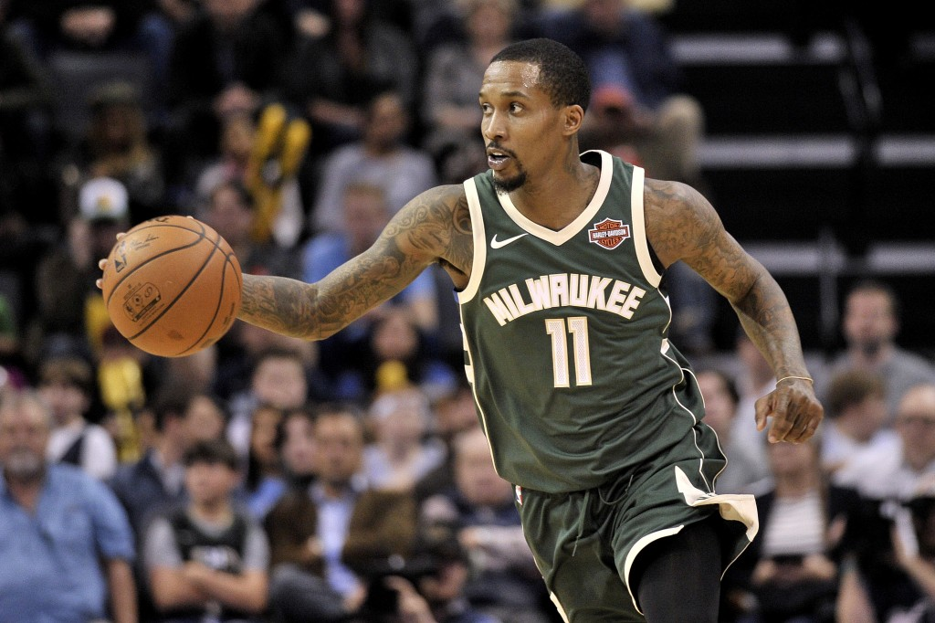 Milwaukee Bucks guard Brandon Jennings (11) brings the ball upcourt in the first half of an NBA basketball game against the Memphis Grizzlies, Monday,
