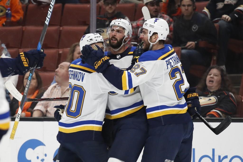 St. Louis Blues' Robert Bortuzzo, center, celebrates his goal with Nikita Soshnikov, left, of Russia, and Alex Pietrangelo during the first period of