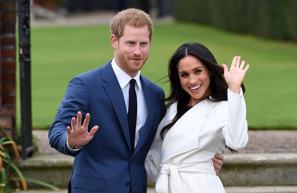FILE - In this Nov. 27, 2017 file photo, Britain's Prince Harry, left, and Meghan Markle pose for the media at Kensington Palace in London. The royal