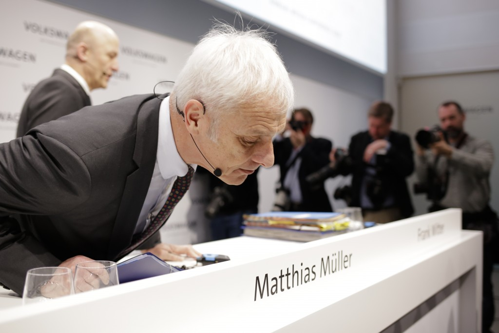 VW group CEO Matthias Mueller, front, and CFO Frank Witter, back ground left, arrive for the annual media conference of the Volkswagen group, in Berli