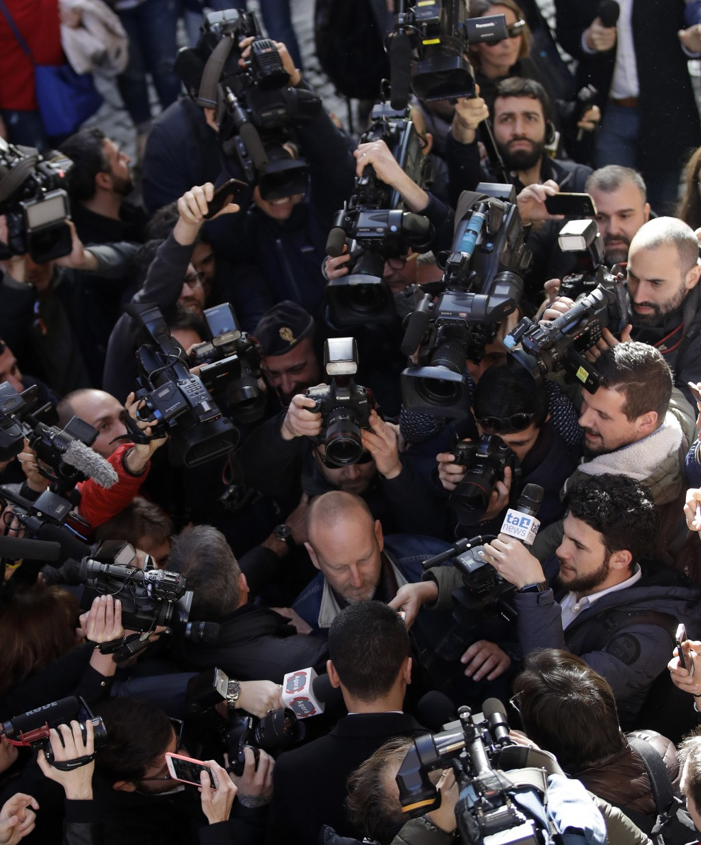 Five-Star Movement leader Luigi Di Maio, center, back to camera, arrives at the foreign press association in Rome, Tuesday, March 13, 2018. (AP Photo/