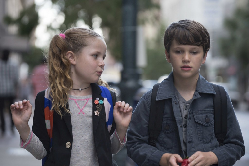 """This image released by Netflix shows Darby Camp, left, and Gabriel Bateman a scene from """"Benji."""" (Netflix via AP)"""