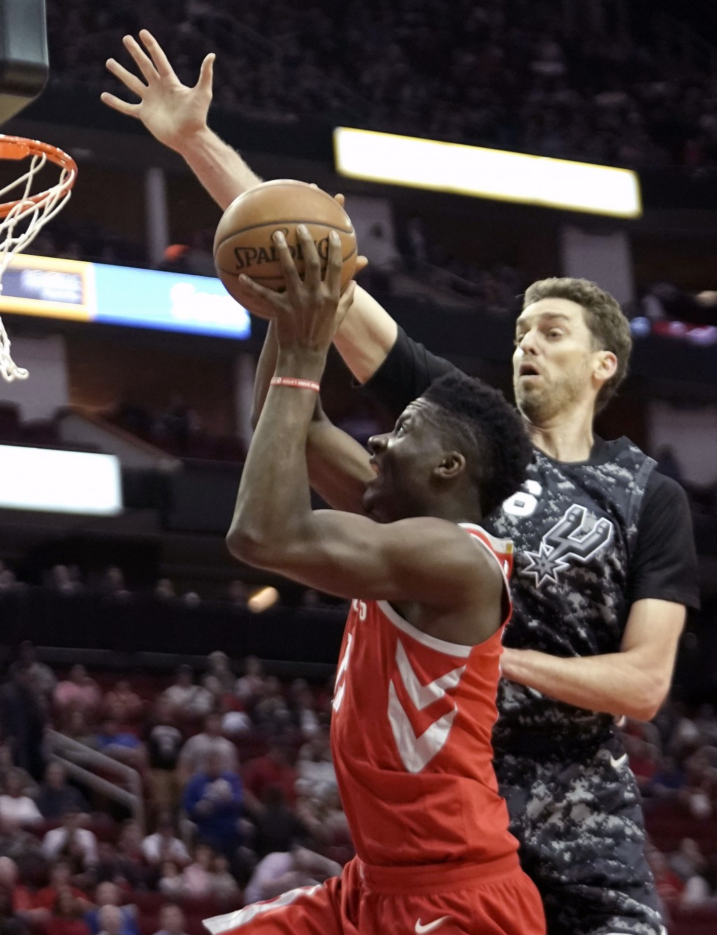 Houston Rockets' Clint Capela, left, is fouled by San Antonio Spurs' Pau Gasol during the first half of an NBA basketball game Monday, March 12, 2018,