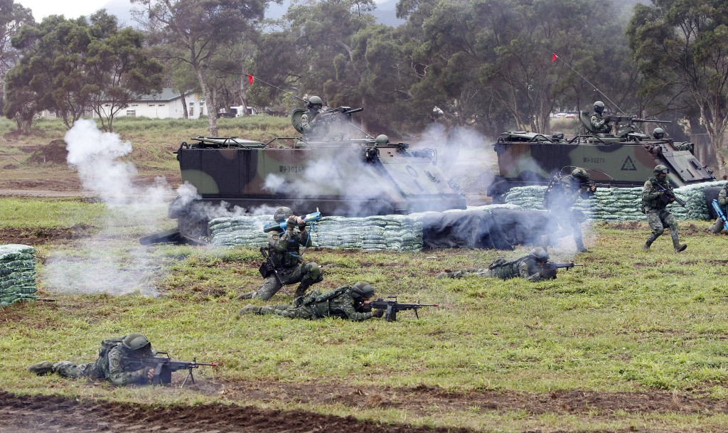 FILE - In this Jan. 30, 2018, file photo, Taiwanese soldiers take part in a military exercises to show its determination to defend itself from China t
