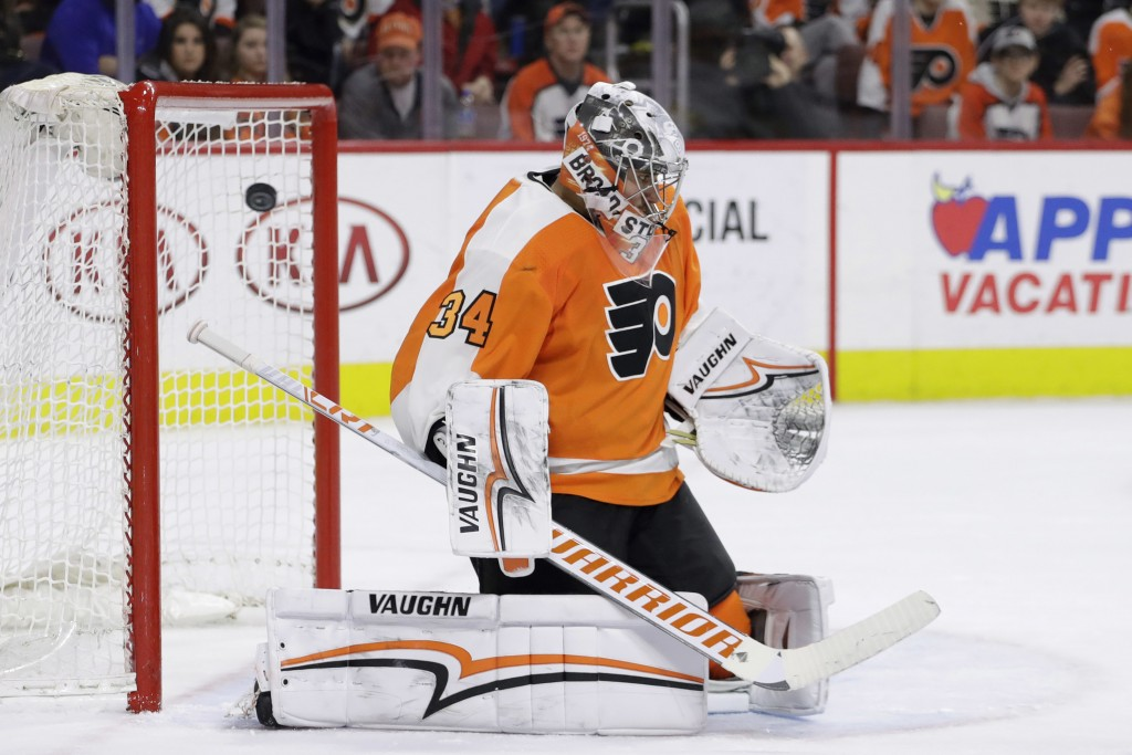 Philadelphia Flyers' Petr Mrazek cannot stop a goal by Vegas Golden Knights' Ryan Carpenter during the third period of an NHL hockey game, Monday, Mar
