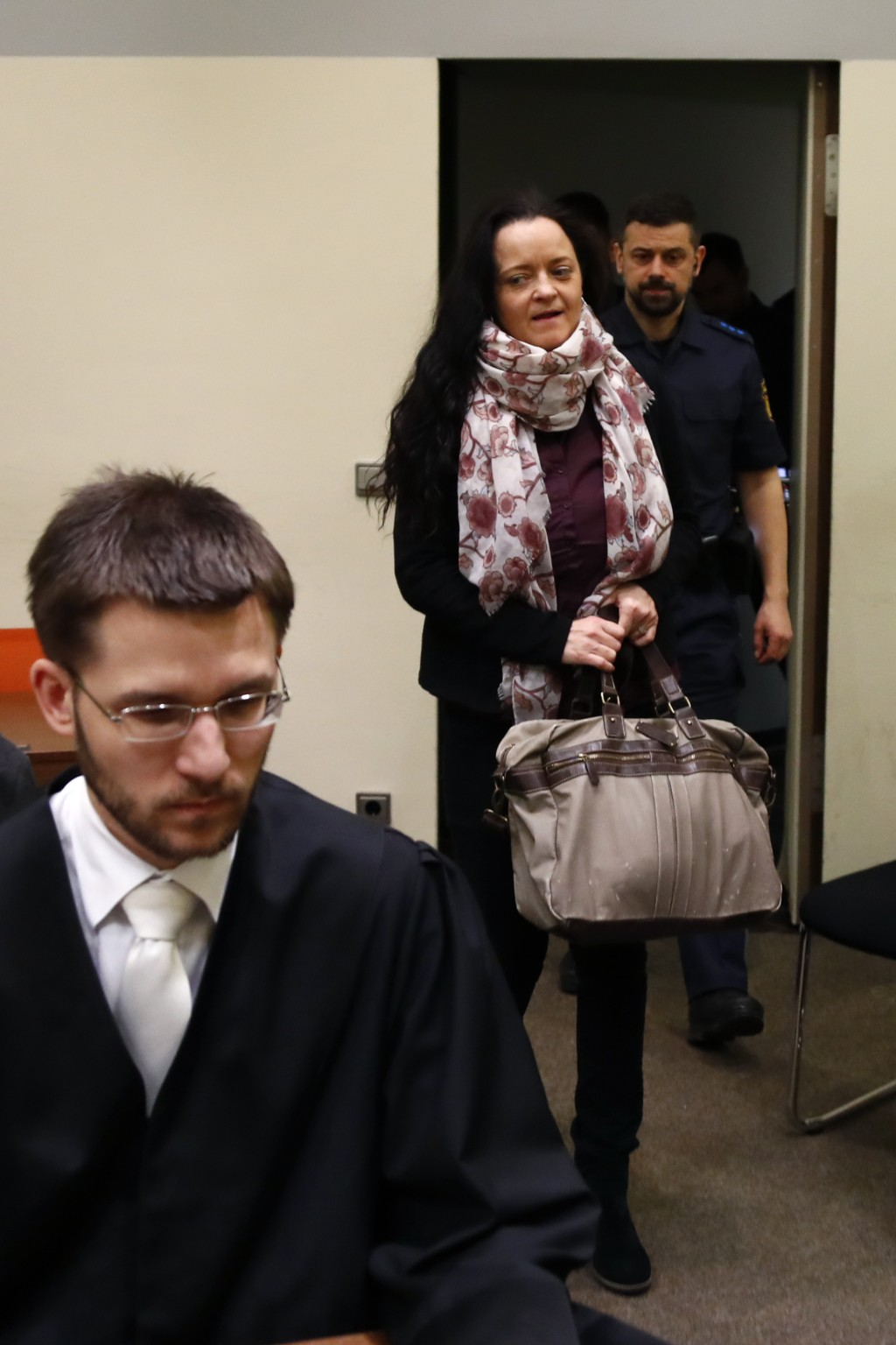 Terror suspect Beate Zschaepe arrives in a court room behind her lawyer Mathias Grasel in Munich, Germany, Tuesday, March 13, 2018. German prosecutors
