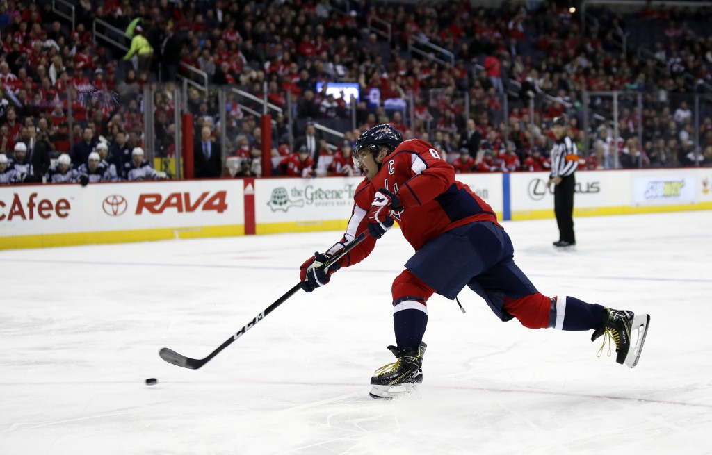 Washington Capitals left wing Alex Ovechkin shoots for a goal in the first period of an NHL hockey game against the Winnipeg Jets, Monday, March 12, 2