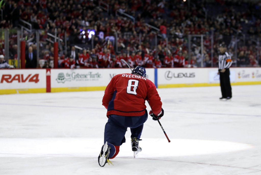 Washington Capitals left wing Alex Ovechkin celebrates his goal in the first period of an NHL hockey game against the Winnipeg Jets, Monday, March 12,