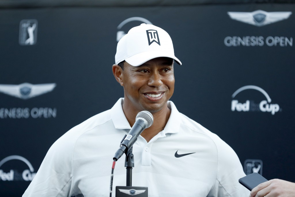 FILE - In this Feb. 16, 2018, file photo, Tiger Woods talks to reporters following his second round of the Genesis Open golf tournament at Riviera Cou