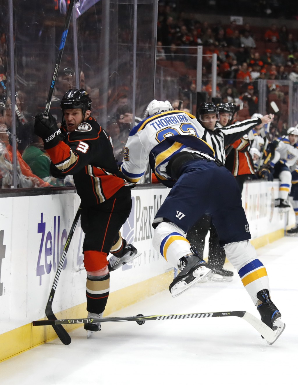 Anaheim Ducks' Kevin Bieksa, left, collides with St. Louis Blues' Chris Thorburn during the first period of an NHL hockey game Monday, March 12, 2018,
