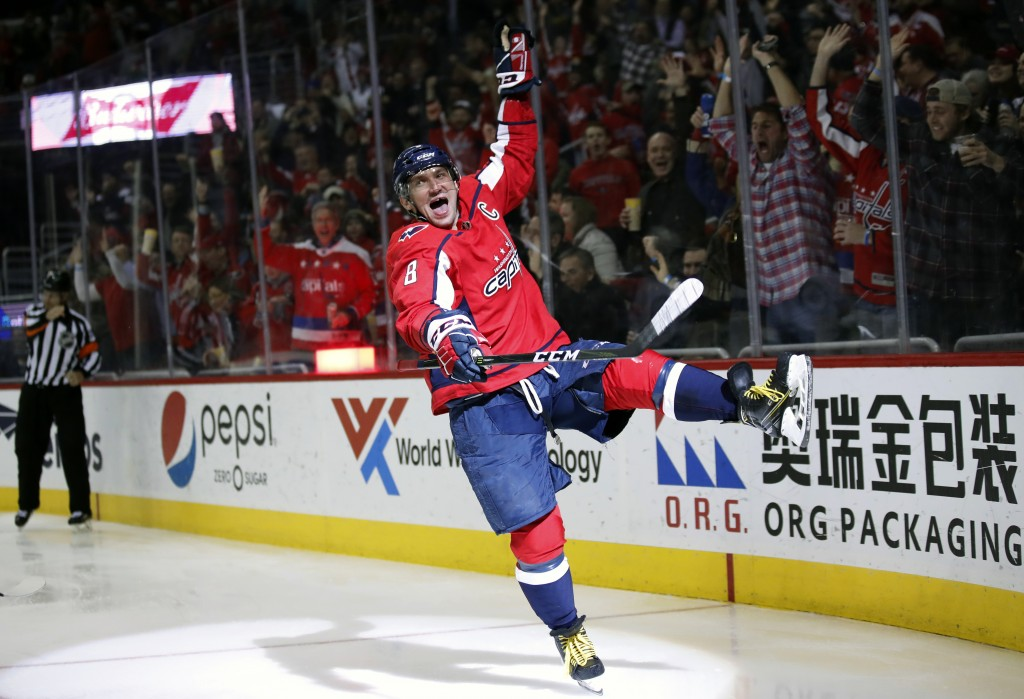 Washington Capitals left wing Alex Ovechkin celebrates his goal in the second period of an NHL hockey game against the Winnipeg Jets, Monday, March 12
