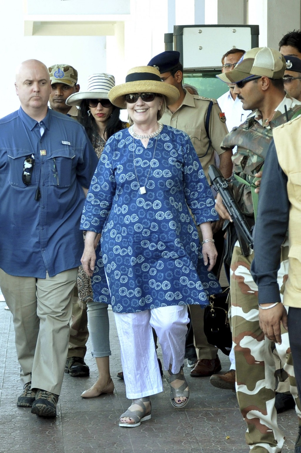 Former U.S. Secretary of State Hillary Clinton, center, comes out of the Jodhpur airport upoon her arrival in Jodhpur, Rajasthan state, India, Tuesday