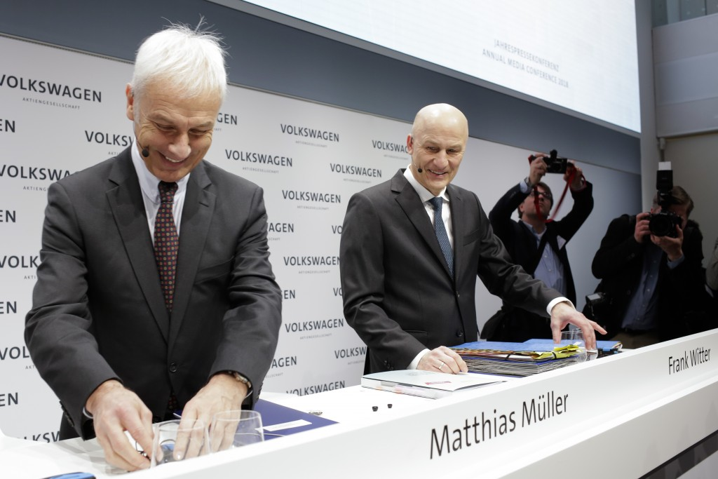 VW group CEO Matthias Mueller, left, and CFO Frank Witter, right, arrive for the annual media conference of the Volkswagen group, in Berlin, Germany,