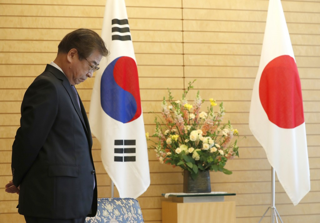 South Korea's National Intelligence Service Chief Suh Hoon waits for the arrival of Japanese Prime Minister Shinzo Abe for a meeting in Tokyo Tuesday,