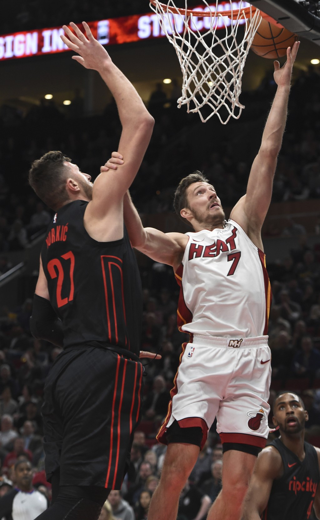Miami Heat guard Goran Dragic (7) drives to the basket against Portland Trail Blazers center Jusuf Nurkic during the first half of an NBA basketball g