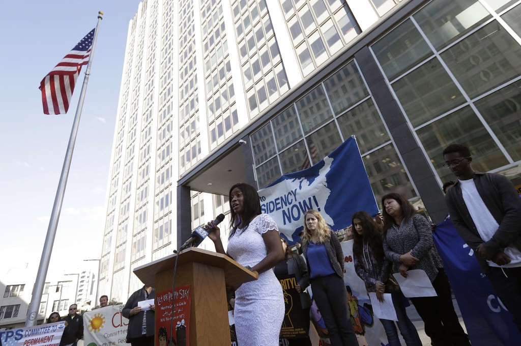 Sherika Blanc, from Haiti, speaks at a news conference announcing a lawsuit against the Trump administration over its decision to end a program that l