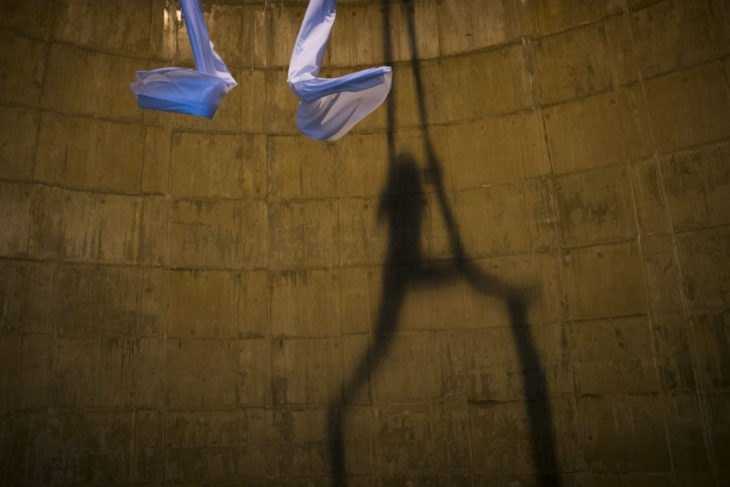 The shadow of aerial dancer Katerina Soldatou is seen as she performs suspended inside a hollow pylon supporting the Rio-Antirrio bridge in southern G