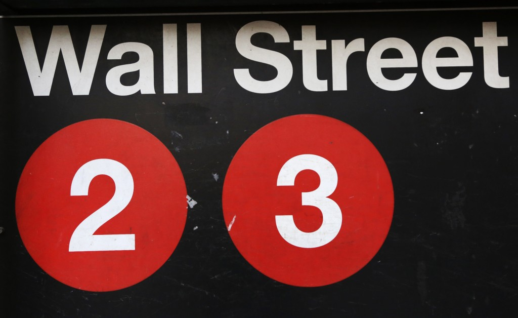 FILE - This Friday, Jan. 15, 2016, file photo shows a sign for a Wall Street subway station in New York. The U.S. stock market opens at 9:30 a.m. EST