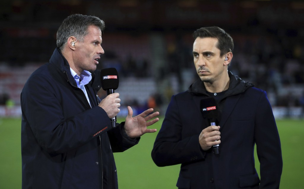 FILE - In this file photo dated Sept. 15, 2017, Sky Sports commentators Jamie Carragher, left, and Gary Neville, at Bournemouth, England.  Former Live