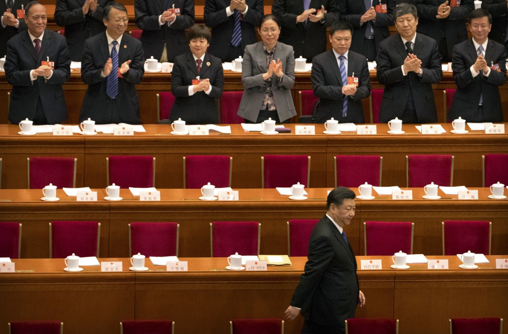 Chinese President Xi Jinping arrives for a plenary session of China's National People's Congress (NPC) in Beijing, Tuesday, March 13, 2018. China's ru