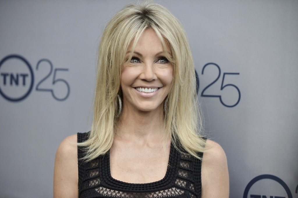 FILE - In a July 24, 2013 file photo, Heather Locklear arrives at the TNT 25th Anniversary Party at The Beverly Hilton Hotel in Los Angeles. Locklear