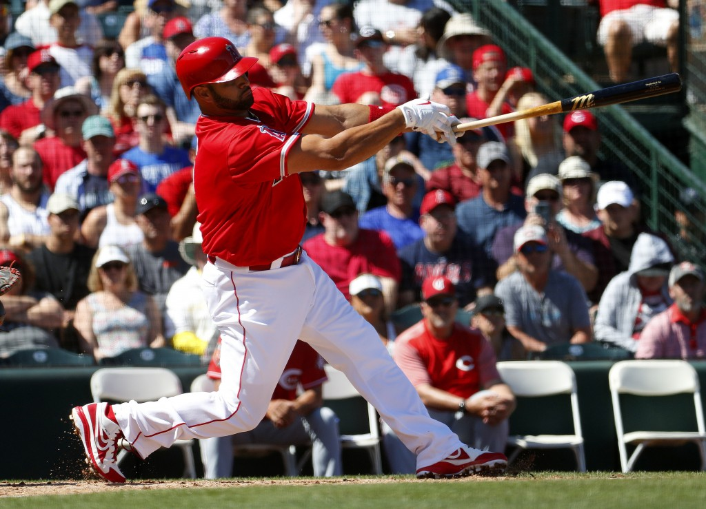 Los Angles Angels; Albert Pujols follow through on an RBI-double against the Cincinnati Reds during the first inning of a spring training baseball gam