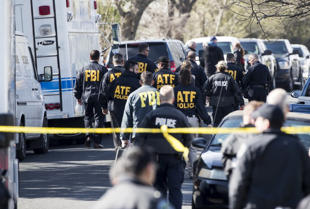 Authorities work on the scene of an explosion in Austin on Monday, March 12, 2018. Two package bomb blasts a few miles apart killed a teenager and wou
