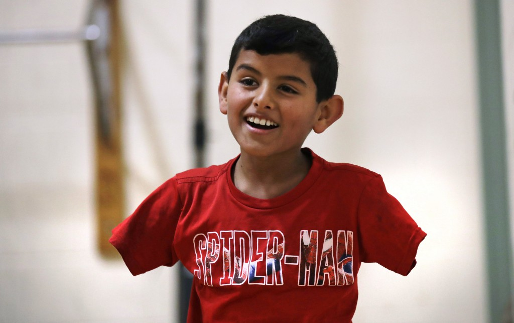 FILE - In this Dec. 10, 2016 file photo, Syrian refugee Ahmad Alkhalaf, whose arms were blown off above the elbows in a refugee camp bomb blast in 201