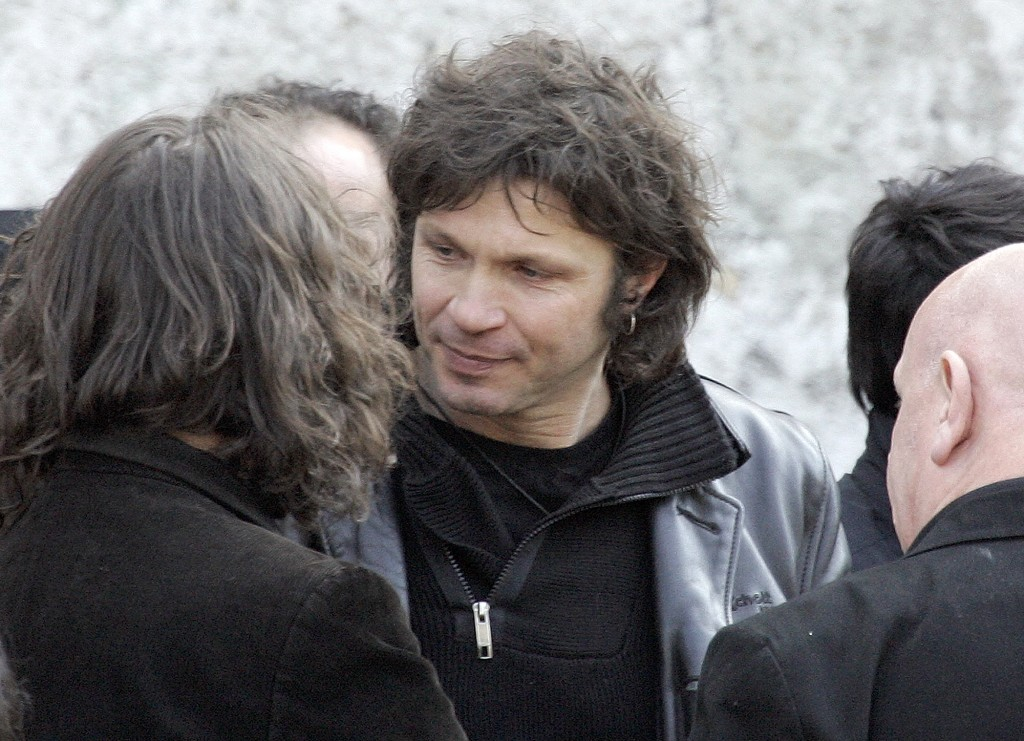 FILE - In this March 20 2009 file photo, French rock singer Bertrand Cantat, center, attends the funeral ceremony of French rock singer Alain Bashung