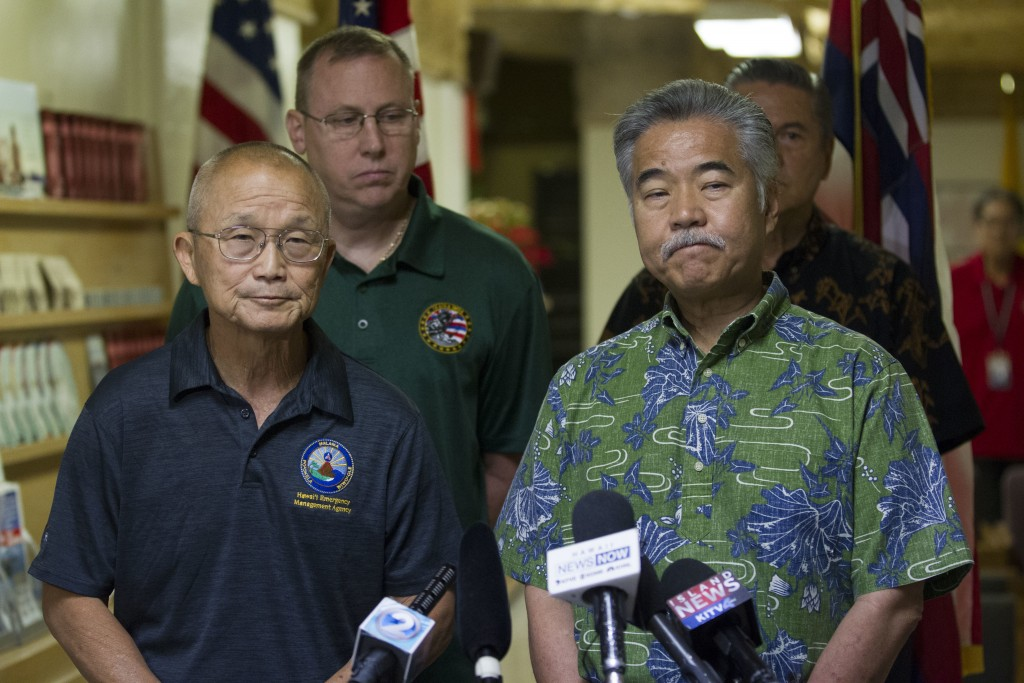 In this Jan. 13, 2018 file photo, Hawaii Gov. David Ige, right, speaks during a news conference with Vern Miyagi, former administrator of the Hawaii E