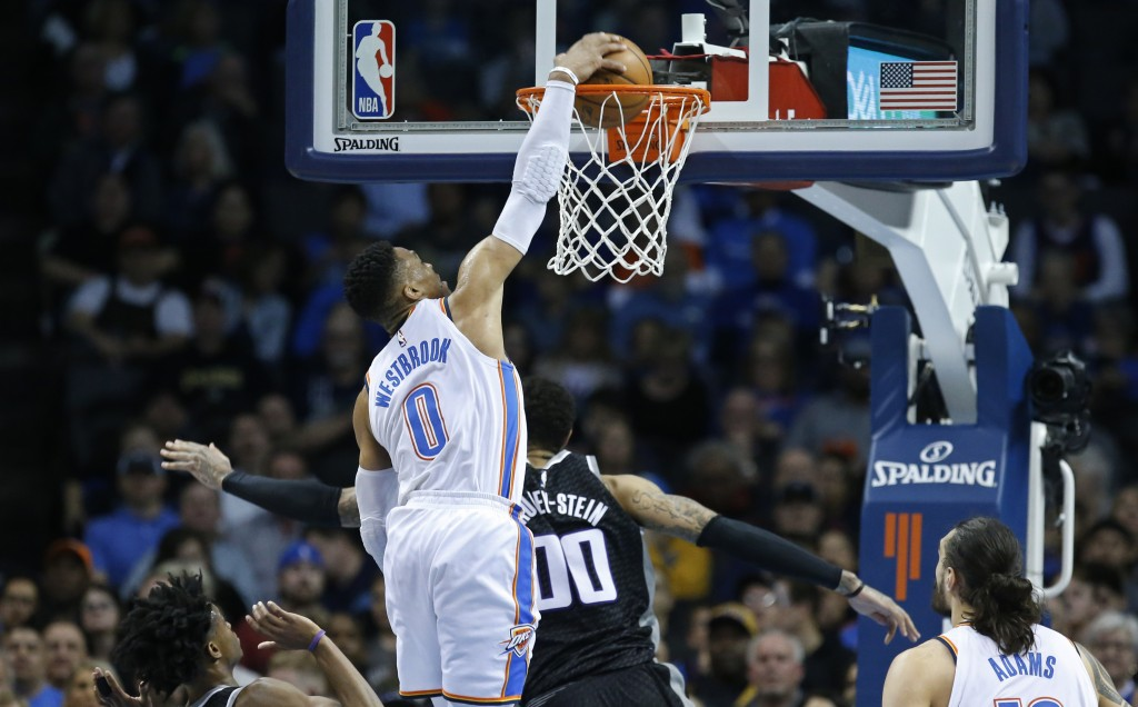 Oklahoma City Thunder guard Russell Westbrook (0) dunks over Sacramento Kings center Willie Cauley-Stein (00) in the first half of an NBA basketball g
