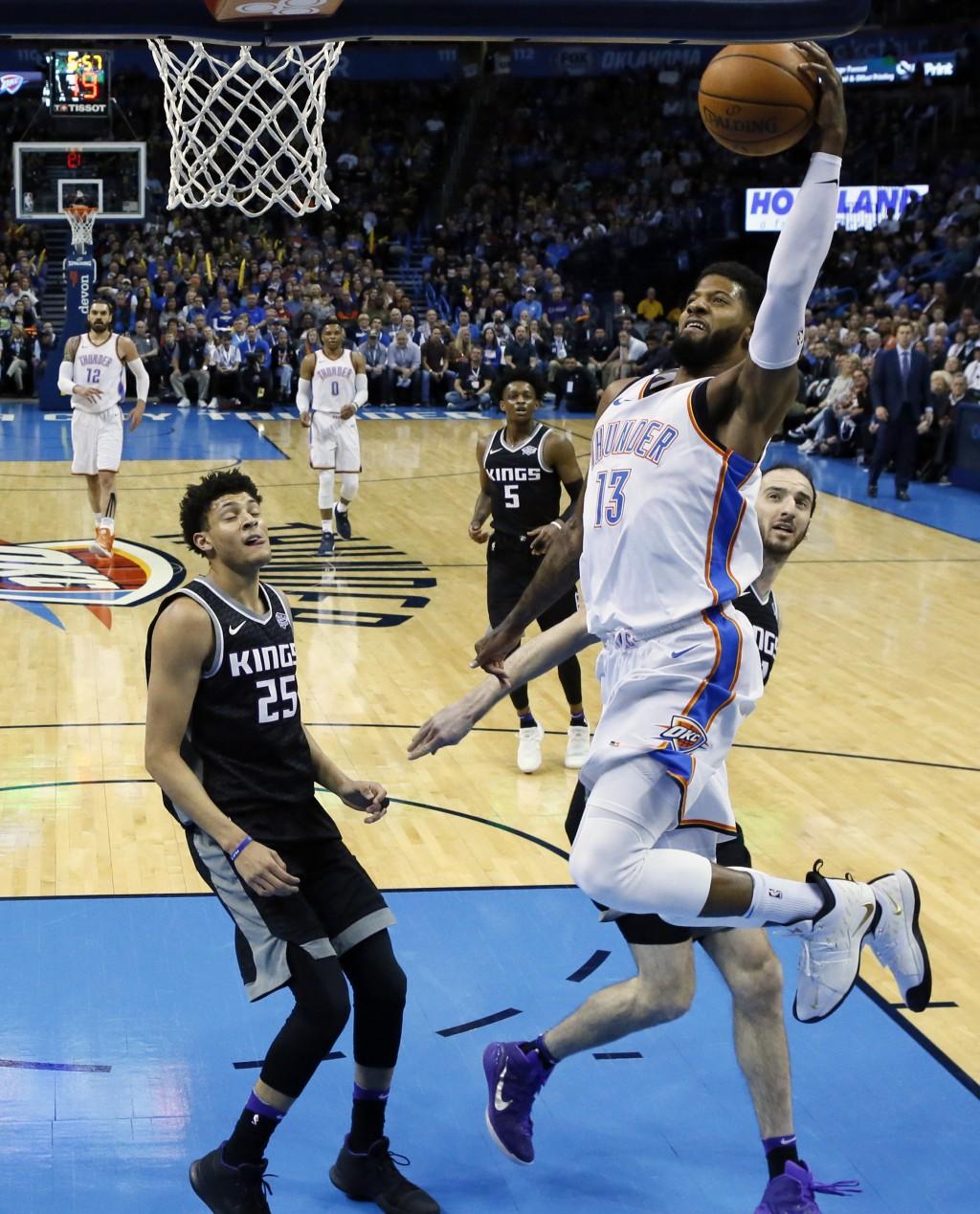 Oklahoma City Thunder forward Paul George (13) shoots in front of Sacramento Kings forward Justin Jackson (25), guard De'Aaron Fox (5) and center Kost