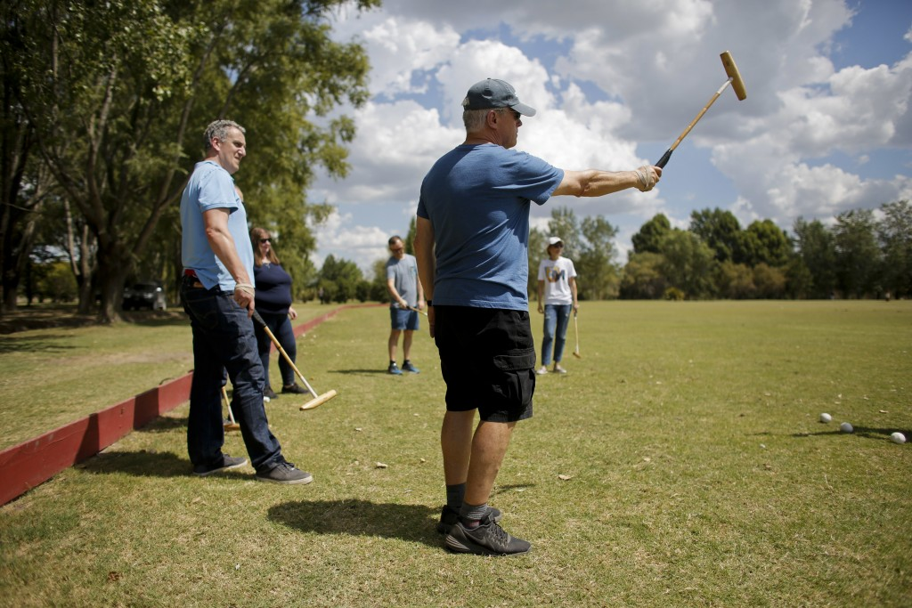 In this Feb. 27, 2018 photo, Jed Hulsey, from Newport Beach, California, right, and Martin Folan, from London, UK, left, practice hitting the ball wit