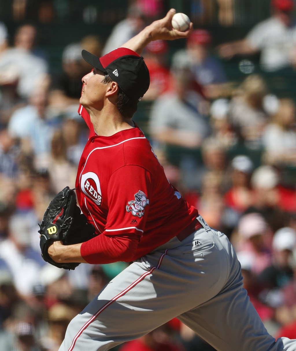 Cincinnati Reds pitcher Homer Bailey throws against the Los Angles Angels during the first inning of a spring training baseball game Monday, March 12,
