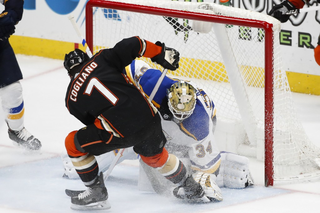 St. Louis Blues goaltender Jake Allen stops a shot by Anaheim Ducks' Andrew Cogliano during the third period of an NHL hockey game, Monday, March 12,