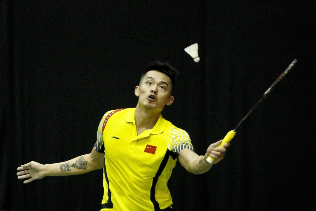 FILE - A Wednesday, Jan. 17, 2018 file photo of two-time Olympic champion, Lin Dan of China returning a shot to Ihsan Maulana Mustofa of Indonesia dur