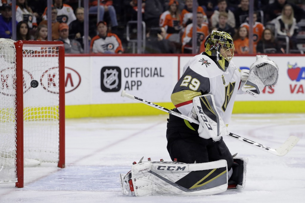 Vegas Golden Knights' Marc-Andre Fleury cannot block goal by Philadelphia Flyers' Claude Giroux during the second period of an NHL hockey game, Monday