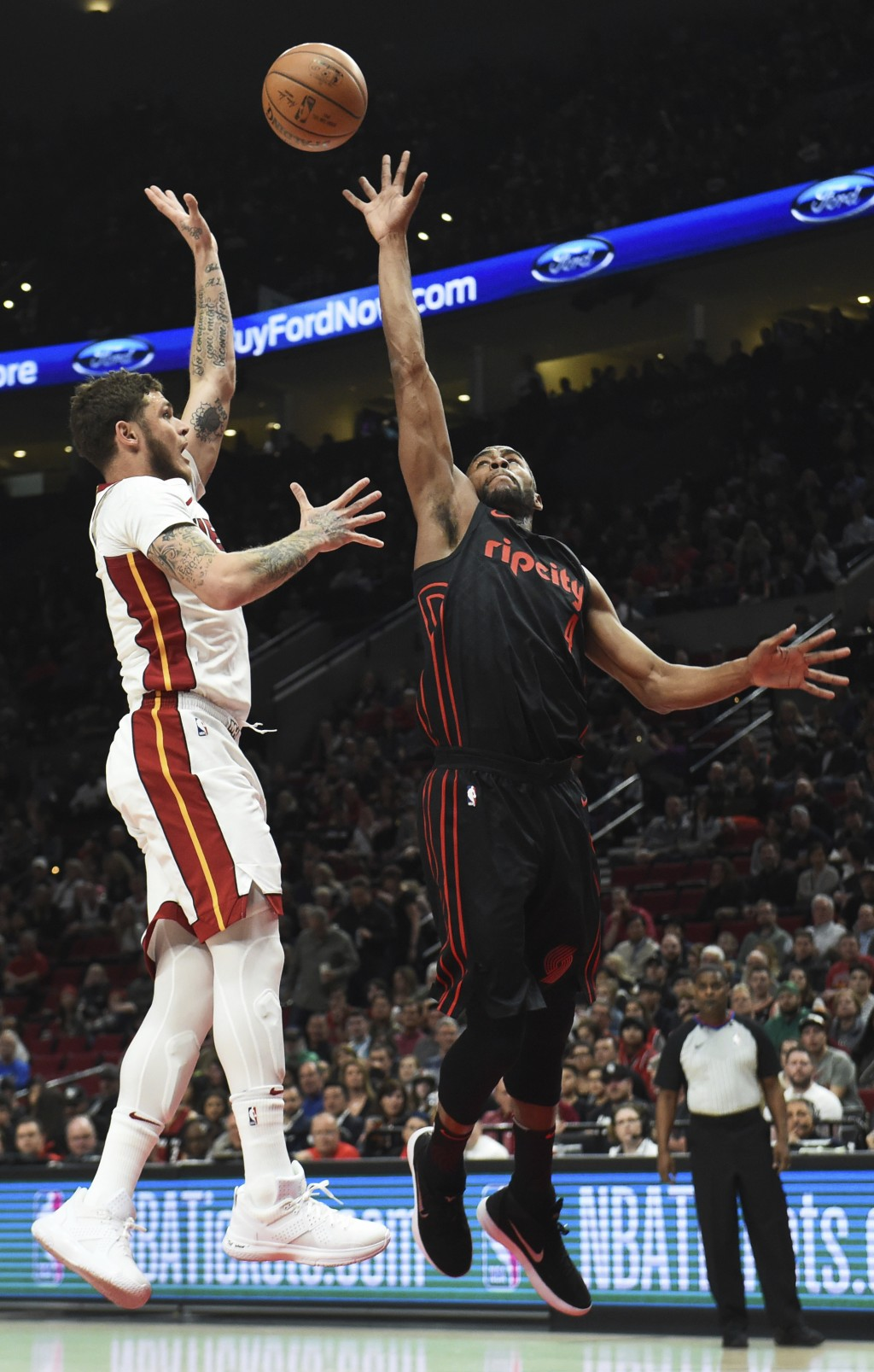 Miami Heat guard Tyler Johnson shoots against Portland Trail Blazers forward Maurice Harkless during the first half of an NBA basketball game in Portl